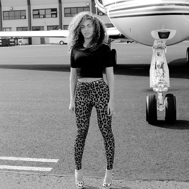 Beyoncé poses for an Instagram picture on an airport runway - 16 April 2014