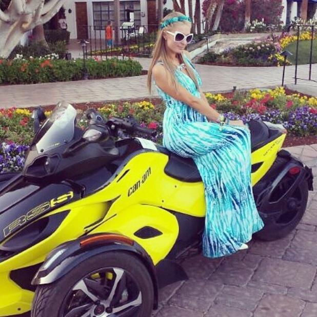 Paris Hilton wears a printed maxi dress as she attends Coachella music festival in California, America - 15 April 2014