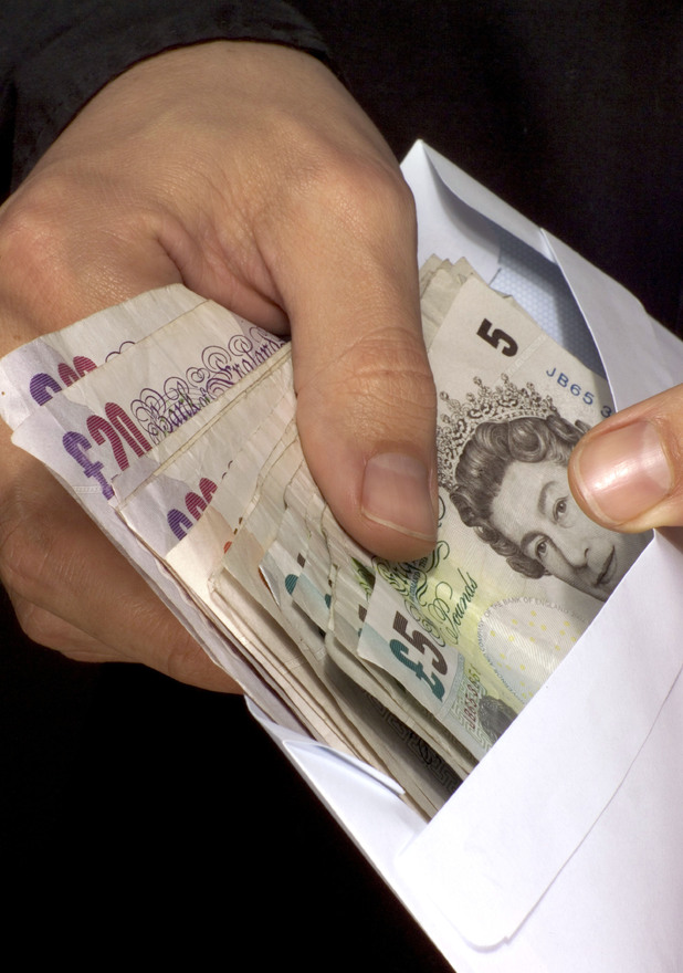 Cash in envelope - residents of Wickham Road in Essex are receiving free wads of cash in the post from a mystery benefactor