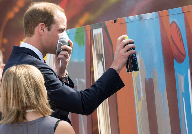 Prince William and Catherine Duchess of Cambridge visit Adelaide, Australia - 23 Apr 2014 William attempts to do some graffiti in Elizabeth