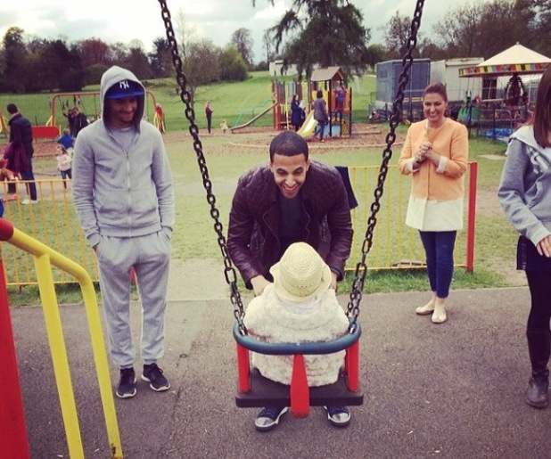 Marvin Humes pushes Alaia-Mai on the swings at the park - 19 April 2014