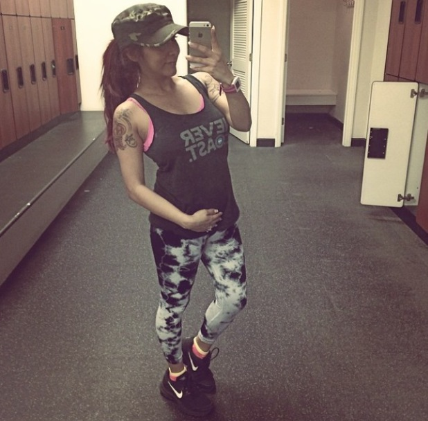 Snooki shows off her tiny baby bump after working out - 23 April 2014