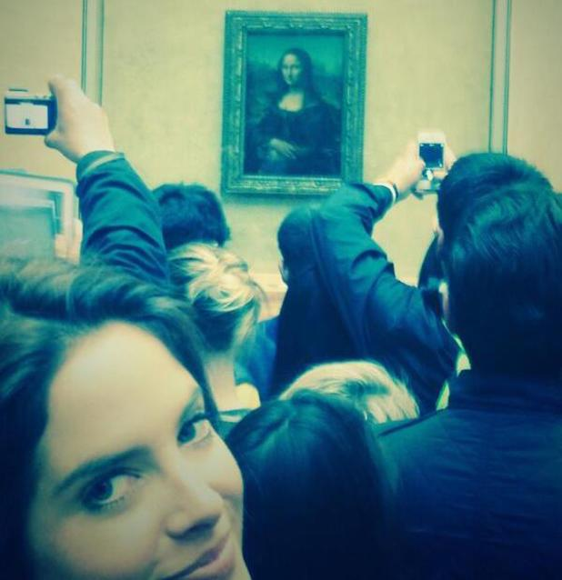 Alex Mytton takes a picture of Binky Felstead in front of the Mona Lisa in Paris - 19 April 2014
