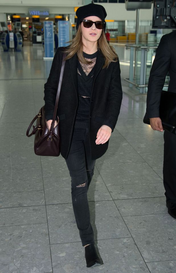 Emma Watson arrives at Heathrow Airport in London, England - 21 April 2014