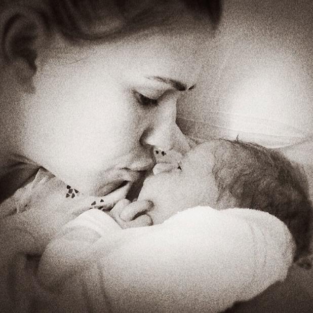 Kevin Federline's wife Victoria Prince cuddlees baby daughter Peyton Marie, 24 April 2014
