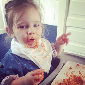 Una Healy's daughter Aoife Belle makes a mess while having dinner, April 2014