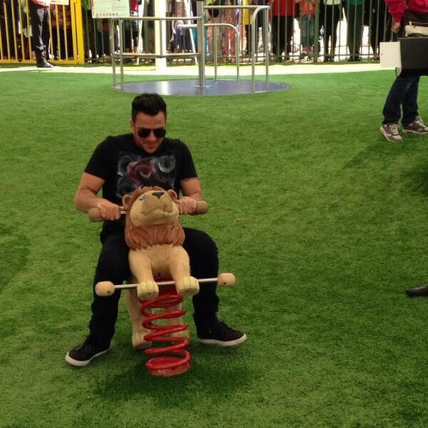 Peter Andre proves he's just a big kid himself as he launches a play park in Wembley, 3 May 2014
