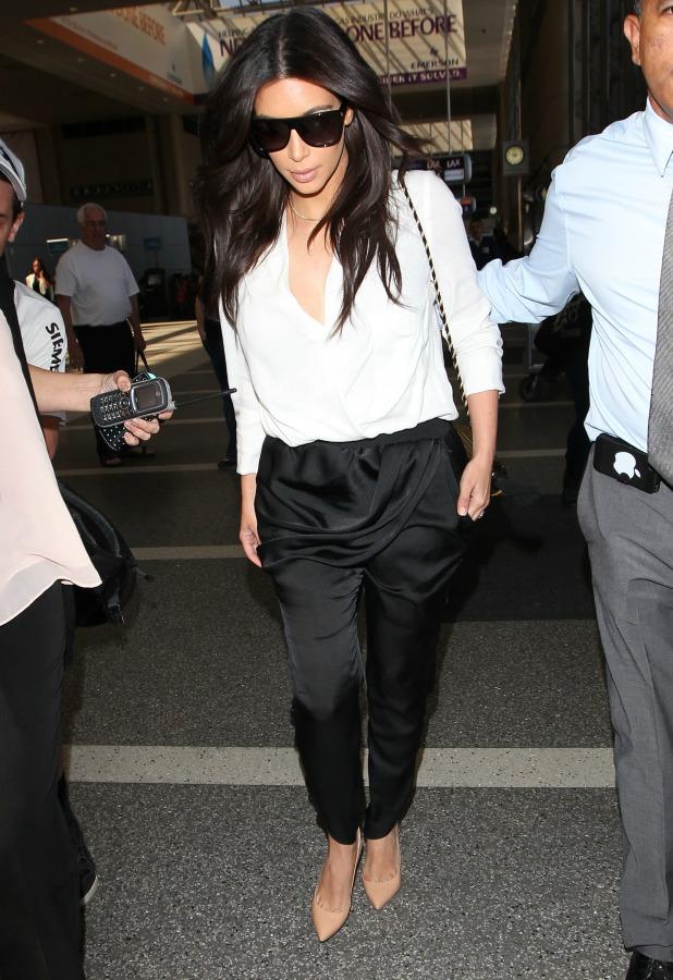 Kim Kardashian arrives at Los Angeles International Airport (LAX) for a flight to Paris, April 2014
