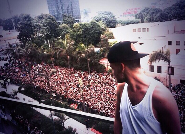 Liam Payne surveys a sea of fans outside his hotel room in Lima, Peru, 27 April 2014