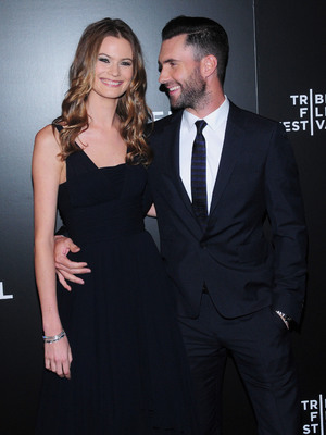 Behati Prinsloo and Adam Levine at the Begin Again premiere at Tribeca Perfoming Arts Center 27 April 2014. NY, United States