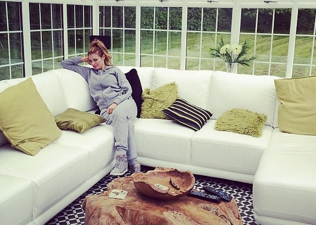 Chloe Sims shares a photo of herself in a tracksuit 6.5.14