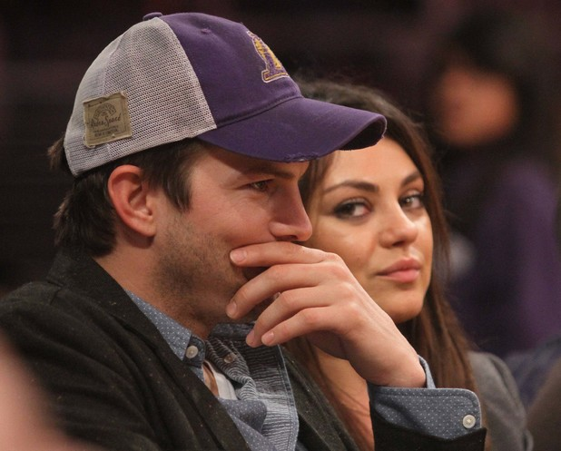 Mila Kunis and Ashton Kutcher at the Los Angeles Lakers game. 01/03/2014 Los Angeles, United States