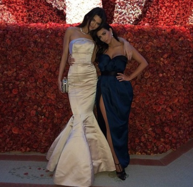 Kendall Jenner stuns in Topshop gown at Met Ball as she poses with sister Kim Kardashian - 5 May 2014