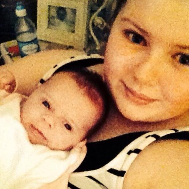 Mollie McFadden (Kerry Katona's daughter) gives baby sister DJ Rose a cuddle - 9 May 2014