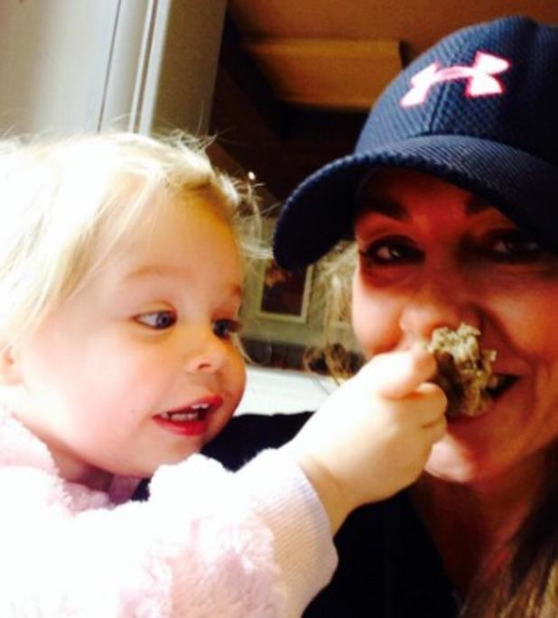 Michelle Heaton fed bread by Faith