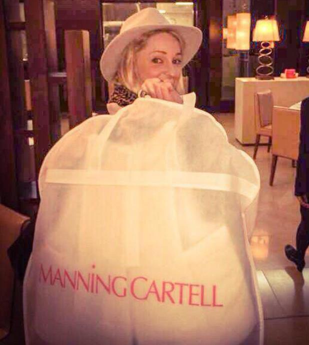 Storm Uechtritz carries dress bag ahead of Gabrielle's Gala, Old Billingsgate, 7 May 2014