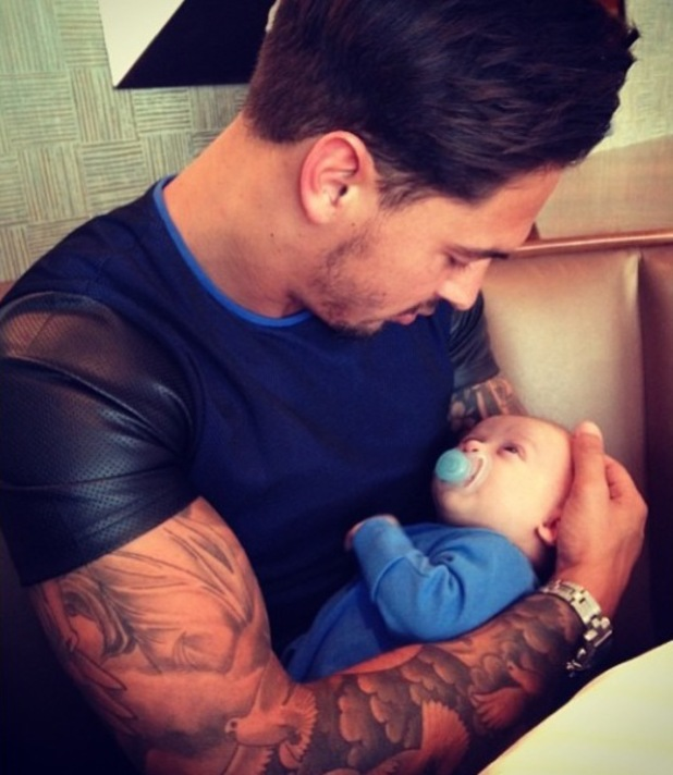 TOWIE's Mario Falcone cuddles up to baby nephew Buzz Michelangelo (7 May).