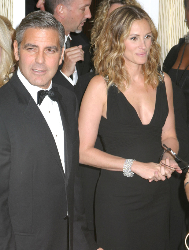 Julia Roberts and George Clooney, Inside the press room at the 21st Annual American Cinematheque Award Honoring George Clooney held at the Beverly Hilton Hotel Beverly Hills, California USA - 13.10.06