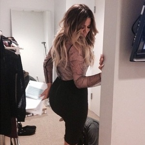 Khloe Kardashian shows off bottom in sheer black lace dress at Chelsea Lately chat show (22 April 2014).