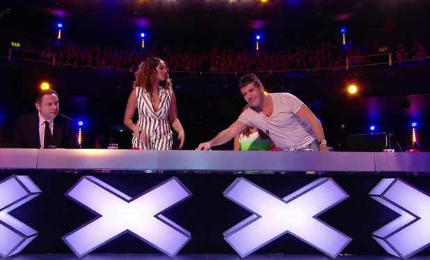 Britain's Got Talent - Simon Cowell presses his golden buzzer for Bars and Melody, aka BAM. (10 May 2014).