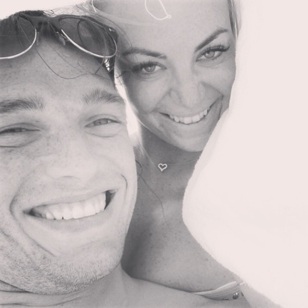 Former TOWIE star Billi Mucklow cuddles up with Andy Carroll during their holiday in Dubai - 15 May 2014