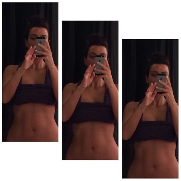 Kim Kardashian shares a picture of her toned stomach after working out in a crop top - 13 May 2014