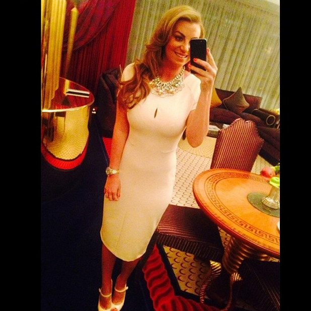 Billi Mucklow takes photograph of outfit before dinner with Andy Carroll in Dubai, 14 May 2014