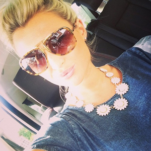 Pregnant Billie Faiers shows off daisy necklace while going shopping. Posted to Instagram May 2014