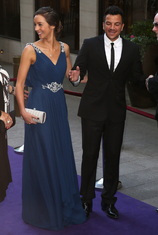 Emily MacDonagh and Peter Andre pictured laughing while arriving at Caudwell Children Butterfly Ball held at The Grosvenor House Hotel in London, UK, 15 May 2014