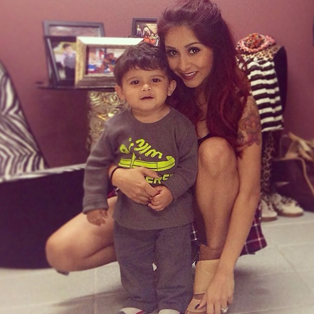 Pregnant Snooki cuddles son Lorenzo on Mother's Day, 11 May 2014