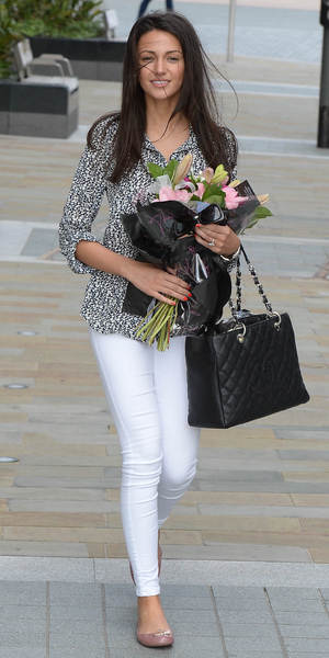 Michelle Keegan leaves Media City Manchester after a press screening with a bouquet