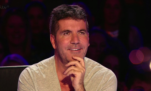 Simon Cowell watching Darcy Oake's performance on Britain's Got Talent