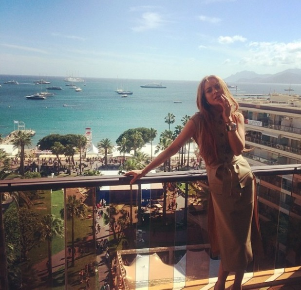 Lindsay Lohan poses on a balcony at the Cannes Film Festival, 18 May 2014