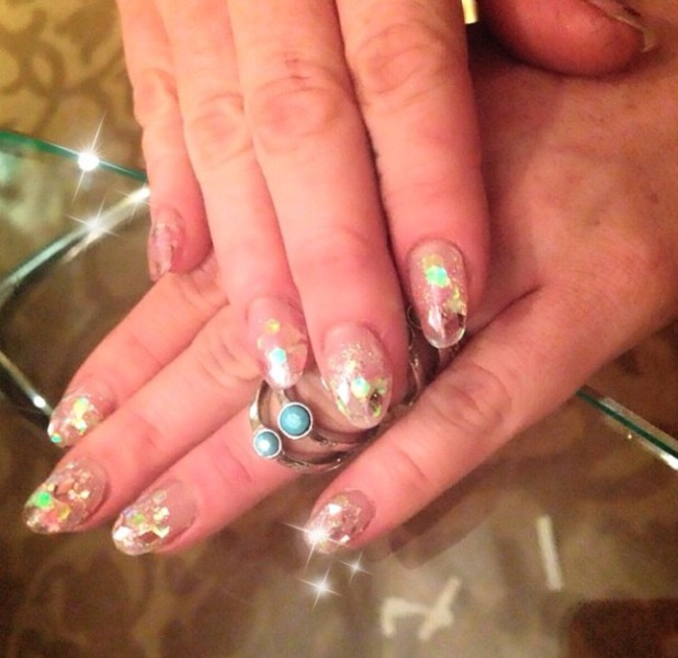 Lindsay Lohan shows off her super-sparkly nails, by manicurist Sophy Robson, Cannes Film Festival, 18 May 2014