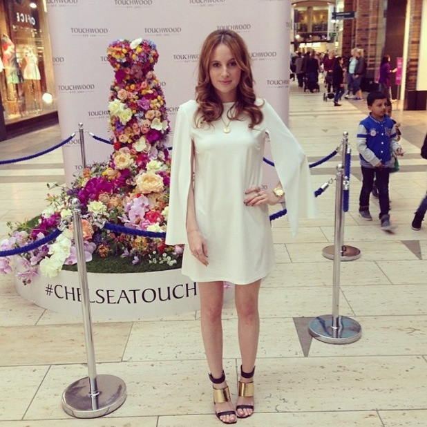 Made In Chelsea's Rosie Fortescue wears a £38 white dress as she appears at Touchwood Shopping Centre in Solihull, England - 22 May 2014