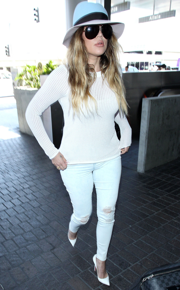 Khloe Kardashian wears a white outfit as she steps out at Los Angeles International Airport in America - 19 May 2014