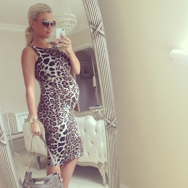 Billie Faiers shows off baby bump in leopard print dress, Essex, 21 May 2014