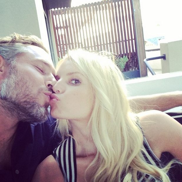 Jessica Simpson and Eric Johnson share a kiss on their fourth wedding anniversary, 22 May 2014