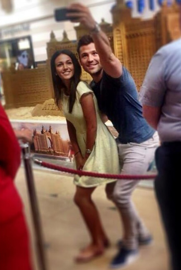Michelle Keegan and Mark Wright take a selfie beside a huge sandcastle devised by Atlantis Resort at Bluewater, May 2014