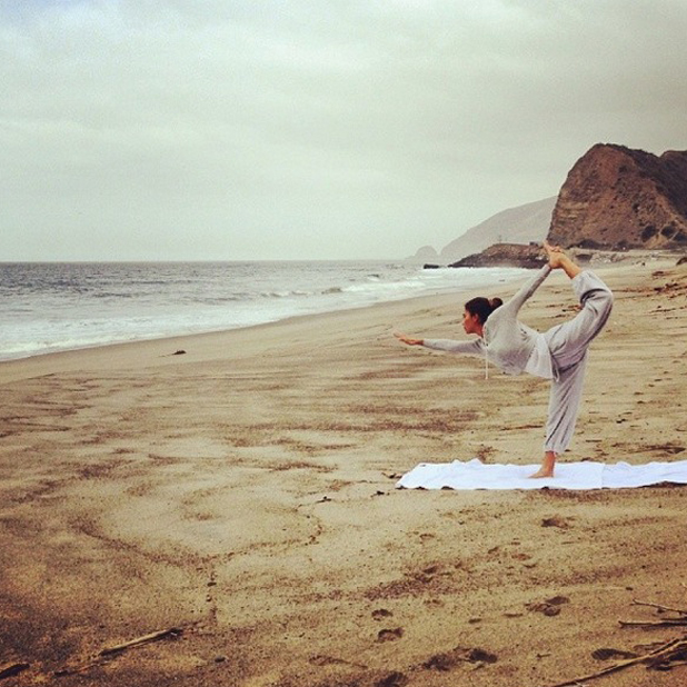 Nicole Scherzinger does yoga on the beach before filming new music video in Malibu, 19 May 2014