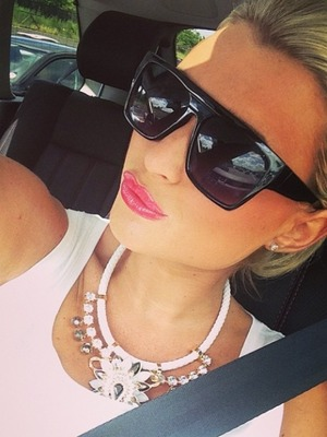 Billie Faiers takes a photo in her car, May 14.