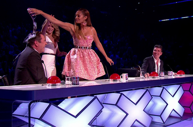 Alesha Dixon pours a glass of water over David Walliams head for saying that when she sings she mimes, during 'Britain's Got Talent Semi Final - Live Show' - 26 May 2014.