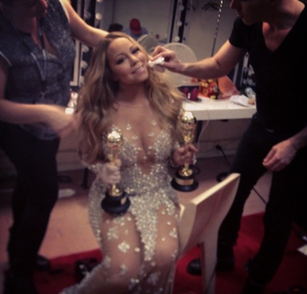 Mariah Carey's holds her two awards backstage at the World Music Awards (27 May).