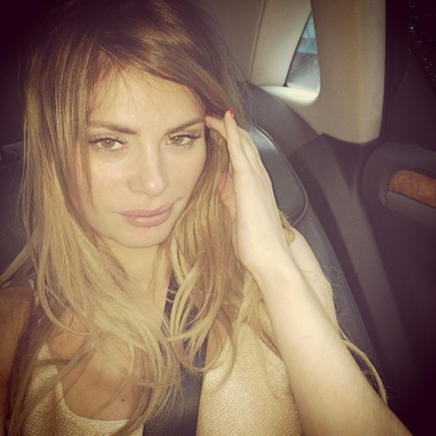 TOWIE's Chloe Sims takes a no make-up selfie while heading to the airport - 28 May 2014