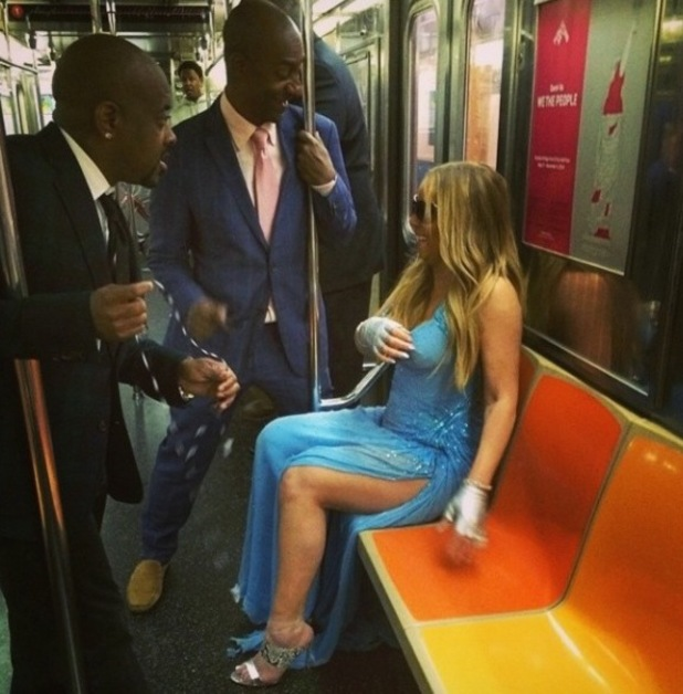 Mariah Carey jumps on the subway in New York (29 May).