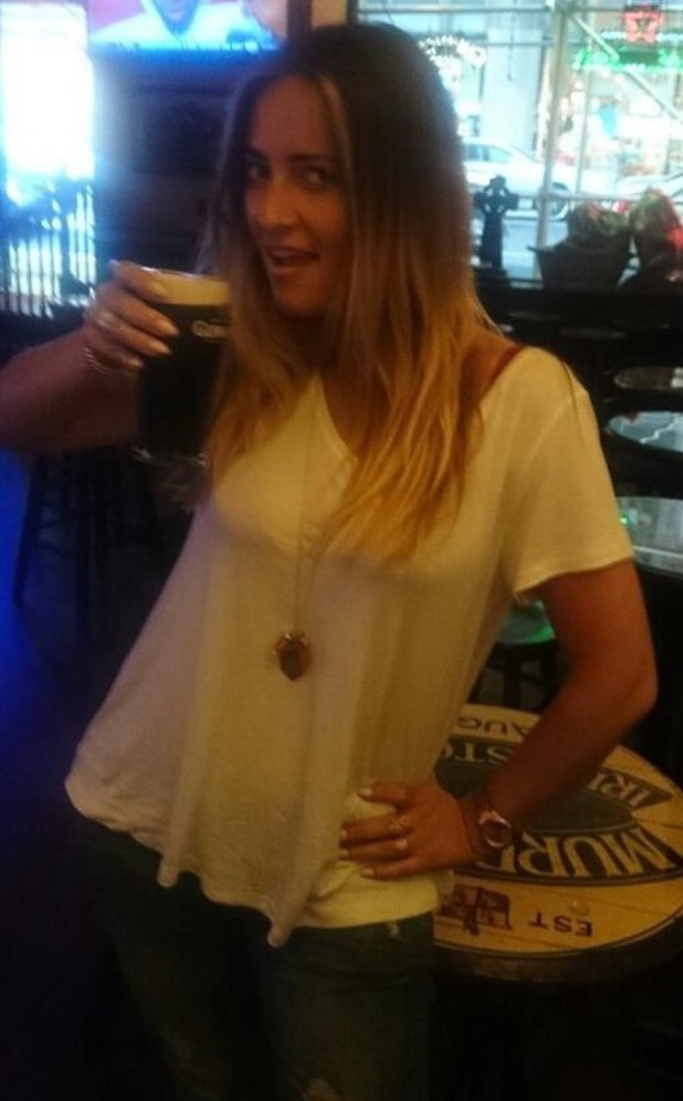 Francesca Newman-Young with a pint of Guinness in NYC