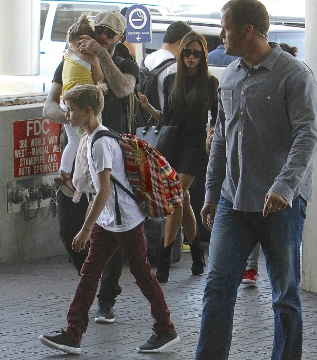 David and Victoria Beckham leave Los Angeles International (LAX) airport with their children, 31 May 2014