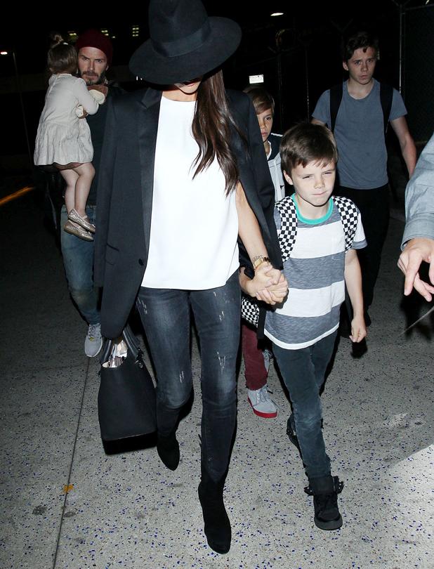 David Beckham, Victoria Beckham with kids Romeo Beckham, Brooklyn Beckham, Cruz Beckham and Harper Beckham arriving at LAX airport 23 May 2014