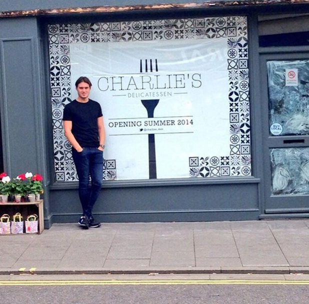 Charlie Sims poses outside his deli on Brentwood High Street, it opens 28 June 2014