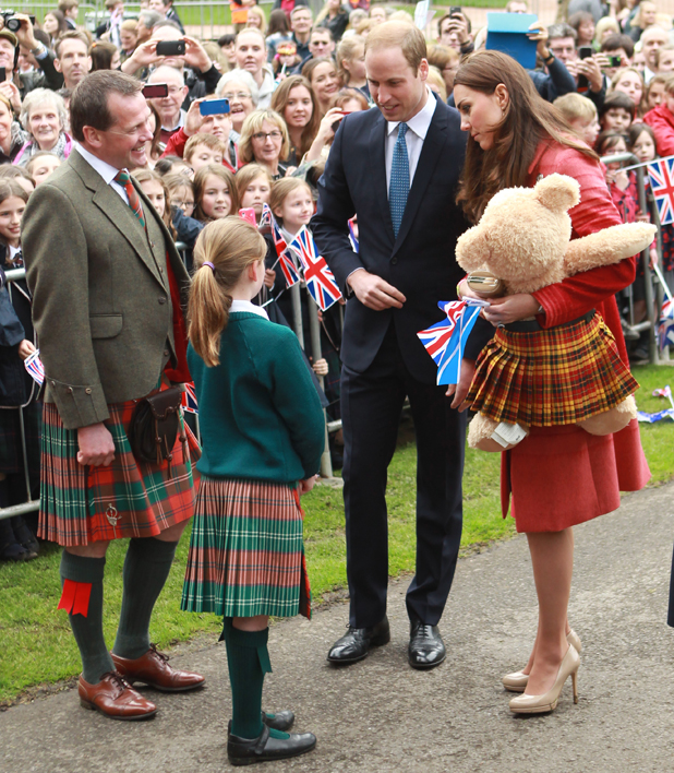 The Duchess of Cambridge is presented with a giant teddy bear wearing Strathearn Tartan in Scotland, 29 May 2014